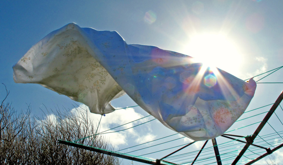 Sky image of washing blowing in breeze by Kate Ferris